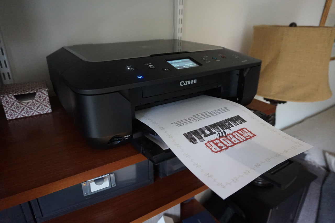 Printing downloadable mystery party kit. How to Host a Murder Mystery Party. #murdermysteryparty www.playingwithmurder.com