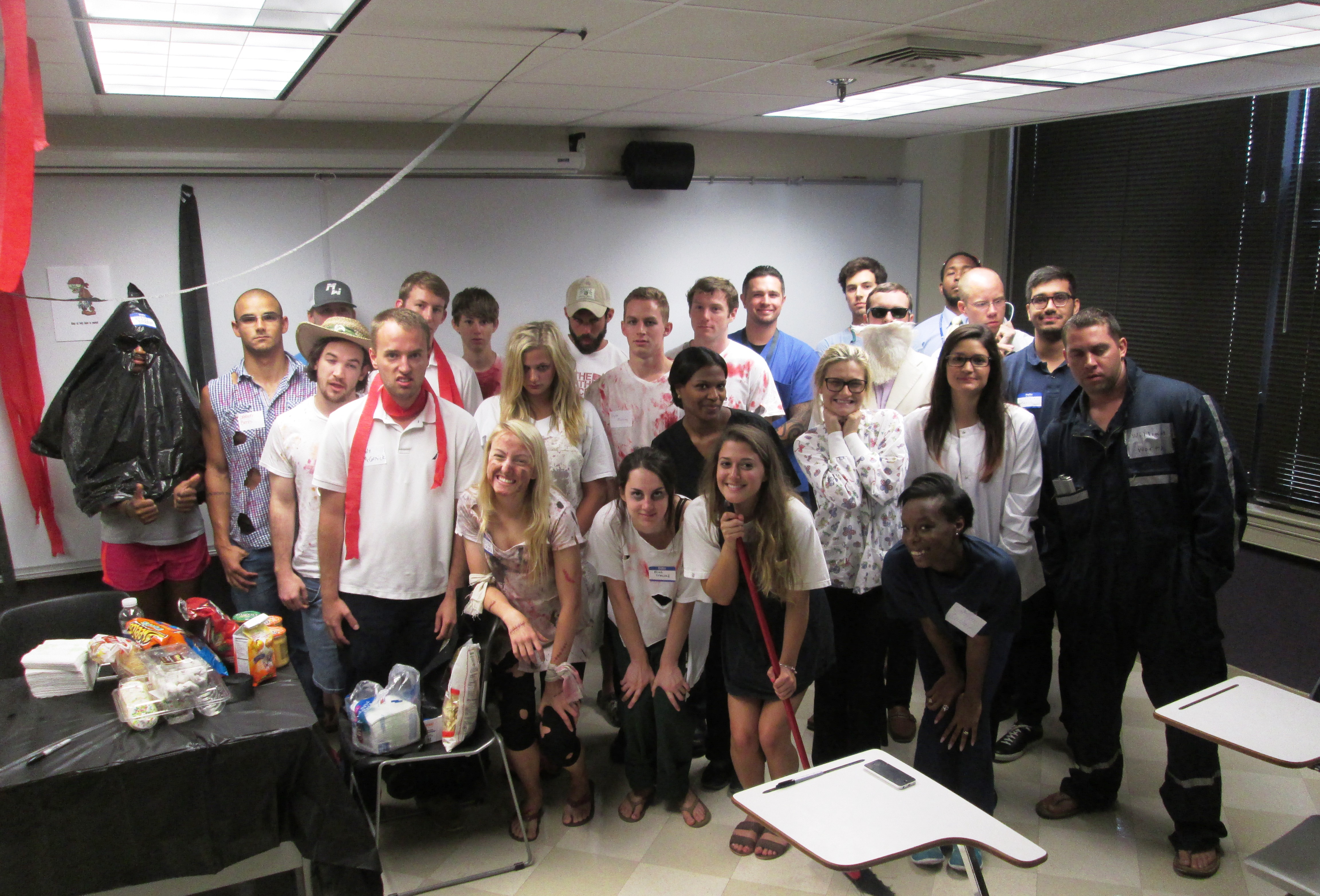 Group shot of class for zombie-themed murder mystery party
